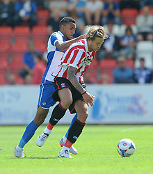 Christian Montano of Bristol Rovers jostles for the ball with Harry Pell of Cheltenham Town - Mandatory by-line: Dougie Allward/JMP - 25/07/2015 - SPORT - FOOTBALL - Cheltenham Town,England - Whaddon Road - Cheltenham Town v Bristol Rovers - Pre-Season Friendly