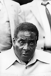 """File photo dated April 18, 1980 of Zanu's (Zimbabwe African National Union) leader Robert Mugabe, the new Prime Minster of Zimbabwe, ex-Rodhesia. The military has seized control in Zimbabwe but has said President Robert Mugabe, in power since 1980, is safe. After seizing state TV, an army spokesman announced it was targeting people close to Mr Mugabe who had caused """"social and economic suffering"""". The move came after Mr Mugabe sacked his deputy, Emmerson Mnangagwa, in favour of his wife, Grace. Photo by Gerald Buthaud/ANDBZ/ABACAPRESS.COM"""