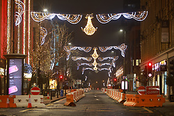 © Licensed to London News Pictures . 31/12/2020. Manchester, UK. Deansgate, which has been packed with revelers in previous years, is seen with no people . The streets of Manchester stand empty overnight (31st December 2020 to 1st January 2021) as Manchester enters the New Year under tier 4 of the government's Coronavirus lockdown . Photo credit: Joel Goodman/LNP