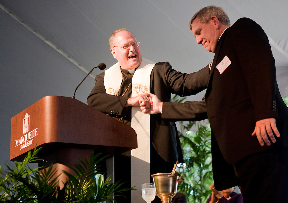 Archbishop Dolan, former archbishop of Milwaukee and current Archbishop of New York, invites Archbhisop Listecki to the stage to bless Ray and Kay Eckstein Hall, the new home of Marquette University's Law School, Wednesday, Sept. 8, 2010. Approximately 1,600 people turned out for the dedication of the $85 million building.
