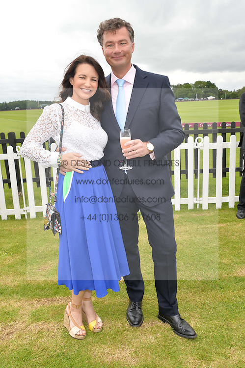 KIRSTIN DAVIS and LAURENT FENIOU MD of Cartier UKat the Cartier Queen's Cup Final polo held at Guards Polo Club, Smith's Lawn, Windsor Great Park, Egham, Surrey on 15th June 2014.