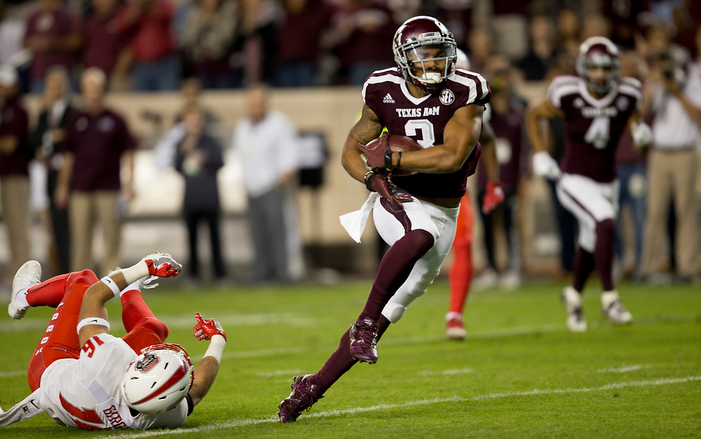 Texas A&M wide receiver Christian Kirk (3) breaks away from New Mexico safety Jacob Girgle (16) for a touchdown after a catch during the first quarter of an NCAA college football game on Saturday, Nov. 11, 2017, in College Station, Texas. (AP Photo/Sam Craft)
