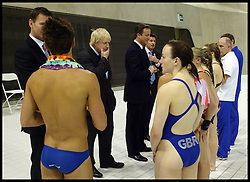 Britain's Prime Minister David Cameron and Mayor of London Boris Johnson together with Jeremy Hunt Secretary of State for Culture, Olympics, Media and Sport Talk to British Diver Tom Daley and members of the British Diving team during a visit to the Olympic Aquatic Centre on January 9, 2012 in London, England. Cameron held a cabinet meeting at the 2012 Olympic Games site and highlighted the 'lasting legacy' the London 2012 Olympics will leave, as the London Olympics countdown enters its final 200 days, Monday January 9, 2012. Photo By Andrew Parsons/ i-Images