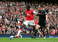 Photo: Tom Dulat.<br /> Arsenal v Bolton Wanderers. The FA Barclays Premiership. 20/10/2007.<br /> Andrew O'brien of Bolton Wanderers and Emmanuel Adebayor of Arsenal racing with the ball.