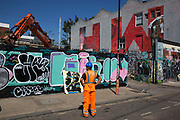 Street art HW initialled Olympic Coca Cola mural in Hackney Wick, East London, United Kingdom. Street art in the East End of London is an ever changing visual enigma, as the artworks constantly change, as councils clean some walls or new works go up in place of others. While some consider this vandalism or graffiti, these artworks are very popular among local people and visitors alike, as a sense of poignancy remains in the work, many of which have subtle messages. (photo by Mike Kemp/In Pictures via Getty Images)