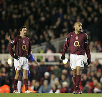Photo: Lee Earle.<br /> Arsenal v Chelsea. The Barclays Premiership. 18/12/2005. Arsenal's Robert Pires (L) and Thierry Henry look dejected at the end of the game after losing to rivals Chelsea.
