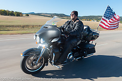 Tom Pranger, US Army Vet and Chapter 22 of the Rapid City American Legion Riders, on his 2014 HD Ultra riding in the USS South Dakota submarine flag relay across South Dakota on the first day from Sturgis to Aberdeen. SD. USA. Saturday October 7, 2017. Photography ©2017 Michael Lichter.