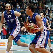 Anadolu Efes's Thomas Heurtel (R) and Nenad Krstic (L) during their Turkish basketball league match Besiktas integral Forex between Anadolu Efes at BJK Akatlar Arena in Istanbul, Turkey, Monday, January 05, 2015. Photo by TURKPIX