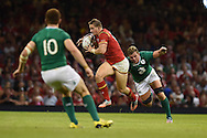 Hallam Amos of Wales ©  breaks away from Ireland's Eoin Reddan ®. Wales v Ireland rugby union international, RWC warm up friendly match at the Millennium Stadium in Cardiff, South Wales on Saturday 8th August  2015.<br /> pic by Andrew Orchard, Andrew Orchard sports photography.