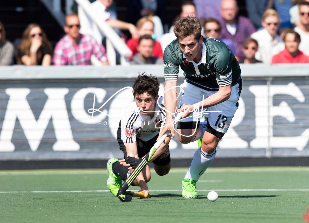 AMSTELVEEN - HOCKEY - Sjoerd Gerretsen (r) van R'dam in duel met Niek Merkus (A'dam)  tijdens de hoofdklasse hockeywedstrijd tussen de heren van Amsterdam en Rotterdam (2-2). COPYRIGHT KOEN SUYK