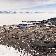 McMurdo Station from T Site. A permit or escort only area because of the sensitive communications equipment up here. That speck in the air is an LC-130 heading for Christchurch, NZ.
