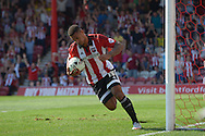 Andre Gray of Brentford takes the ball from the back of the net as he celebrates after he scores his sides first goal of the game to make it 1-2. Skybet football league Championship match, Brentford v Ipswich Town at Griffin Park in London on Saturday 8th August 2015.<br /> pic by John Patrick Fletcher, Andrew Orchard sports photography.