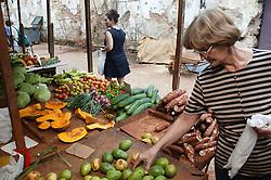 Customers selecting vegetables on stall in Farmers' Market in Havana,