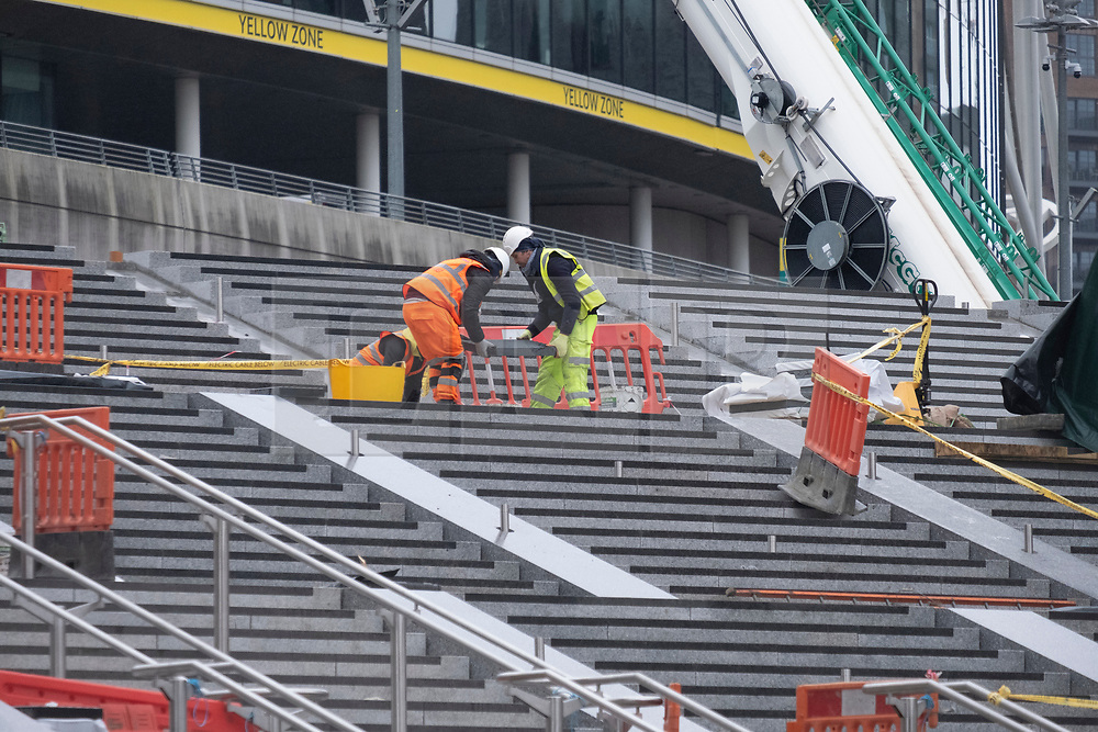 © Licensed to London News Pictures. 05/01/2021. London, UK. Construction workers continue building the new Olympic Steps leading to Wembley Stadium. The steps replace the concrete Pedway ramp and will improve accessibility including 4 lifts. The main construction work is due to finish in February 2021, when the Olympic Steps will be operational for the Carabao Cup Final. Photo credit: Ray Tang/LNP