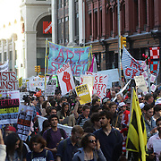 Occupy protesters march down Broadway, New York, on their way to Wall street during the Occupy May Day 2012 action day.  New York, USA. 1st May 2012. Photo Tim Clayton
