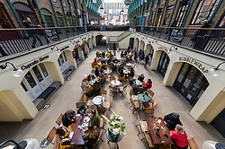 © Licensed to London News Pictures. 12/04/2021. LONDON, UK.  People enjoying outdoor dining in Covent Garden following the UK government's coronavirus roadmap out of lockdown which allowed non-essential businesses to reopen today.  Photo credit: Stephen Chung/LNP