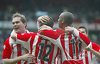 Photo. Andrew Unwin.<br /> Sunderland v Derby County, Nationwide League Division One, Stadium of Light, Sunderland 27/03/2004.<br /> Sunderland's John Oster (12) celebrates scoring his team's first goal with team-mates Marcus Stewart (l) and Darren Byfield (r).