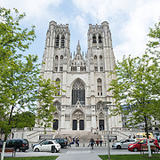 Front of the Cathedral of St. Michael and St. Gudula (in French, Co-Cathédrale collégiale des Ss-Michel et Gudule). A church was founded on this site in the 11th century but the current building dates to the 13th to 15th centuries. The Roman Catholic cathedral is the venue for many state functions such as coronations, royal weddings, and state funerals. It has two patron saints, St Michael and St Gudula, both of whom are also the patron saints of Brussels.
