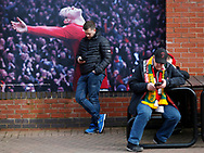 Fans checking their phone before the Premier League match at Old Trafford, Manchester. Picture date: 8th March 2020. Picture credit should read: Darren Staples/Sportimage