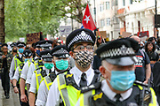 Police wearing surgical face protective masks march along with anti-racism protesters towards Hyde Park in London on Sunday, Aug 30, 2020. (VXP Photo/ Vudi Xhymshiti)