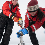 Metta Kaufman and Brenna McConnell from the University of Alaska, Fairbanks, taking ice core samples from the Arctic Ocean.