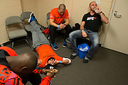 Johny Hendricks and his team relax in their locker room before his title fight against Robbie Lawler at UFC 171 in Dallas, Texas on March 15, 2014.