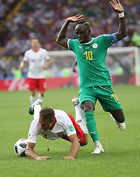 MOSCOW, June 19, 2018  Sadio Mane (R) of Senegal vies with Thiago Cionek of Poland during a Group H match between Poland and Senegal at the 2018 FIFA World Cup in Moscow, Russia, June 19, 2018. (Credit Image: © Fei Maohua/Xinhua via ZUMA Wire)