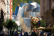 Architect Frank Gehry's Guggenheim Museum futuristic architectural design with Puppy flower feature at Bilbao, Spain