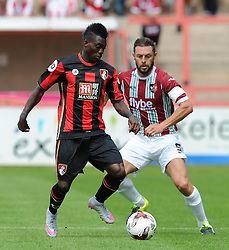 Exeter City's Jamie McAllister challenges for the ball with Bournemouth's Christian Atsu. - Photo mandatory by-line: Harry Trump/JMP - Mobile: 07966 386802 - 18/07/15 - SPORT - FOOTBALL - Pre Season Fixture - Exeter City v Bournemouth - St James Park, Exeter, England.