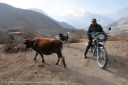 Round the World Doug Wothke heads up to 12,000' at the end of day-5  of our Himalayan Heroes adventure riding from Kalopani through the Mustang District to Muktinath, Nepal. Saturday, November 10, 2018. Photography ©2018 Michael Lichter.
