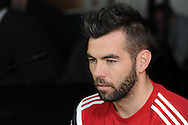 Joe Ledley of Wales talks to the media during the Wales football player media session at the St.Davids Hotel in Cardiff Bay , South Wales on Thursday 14th November 2013. pic by Andrew Orchard, Andrew Orchard sports photography,
