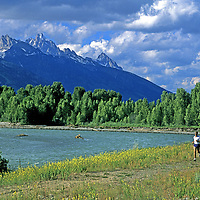 RUNNING Jay Hass running beside the Snake River near Jackson, WY. Grand Tetons (bkg) (MR)