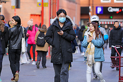 © Licensed to London News Pictures. 01/03/2020. London, UK. An Asian man wearing a surgical face mask in Chinatown as a precaution against new type coronavirus (COVID-19). Twelve more people have tested positive for coronavirus in the UK, bringing the total number of cases to 35. Photo credit: Dinendra Haria/LNP