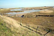 Salt marsh on river Ore looking across to Orford Ness shingle spit, Hollesley, Suffolk