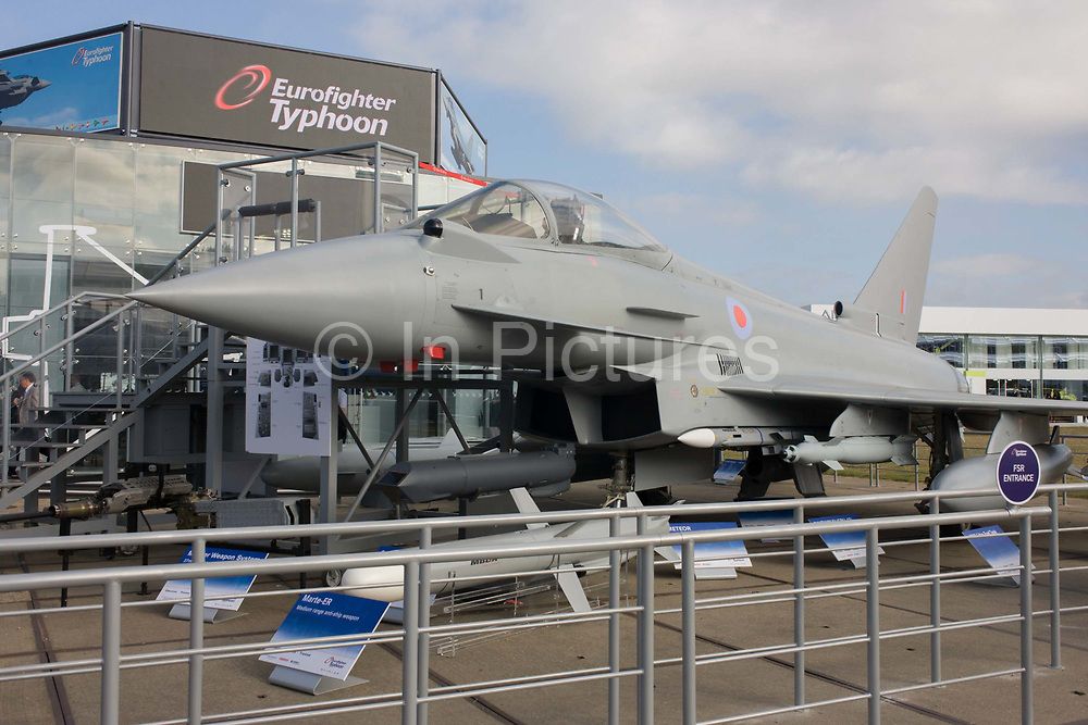 BAE Systems Typhoon jet fighter, exhibited with missile and smart bomb systems, at the Farnborough Air Show, England. The Eurofighter Typhoon is a twin-engine, canard-delta wing, multirole fighter. The Typhoon was designed and is manufactured by a consortium of three companies; BAE Systems, Airbus Group and Alenia Aermacchi, who conduct the majority of affairs dealing with the project through a joint holding company, Eurofighter Jagdflugzeug GmbH, which was formed in 1986. The project is managed by the NATO Eurofighter and Tornado Management Agency, which also acts as the prime customer.