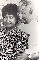 Nelson Mandela has a tender moment with wife Winnie Mandela, 1990.