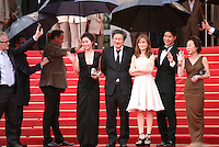 Moon Sori, Hong Sangsoo,  Isabelle Huppert, Yu Junsang, Youn Yuh-jung arriving  on the red steps at the DA-REUN NA-RA-E-SUH (IN ANOTHER COUNTRY)  gala screening at the 65th Cannes Film Festival France. Monday 21st May 2012 in Cannes Film Festival, France.