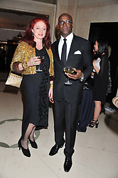CAMILLA LOWTHER and CHARLES ABOAH at the Harper's Bazaar Women of the Year Awards 2011 held at Claridge's, Brook Street, London on 7th November 2011.