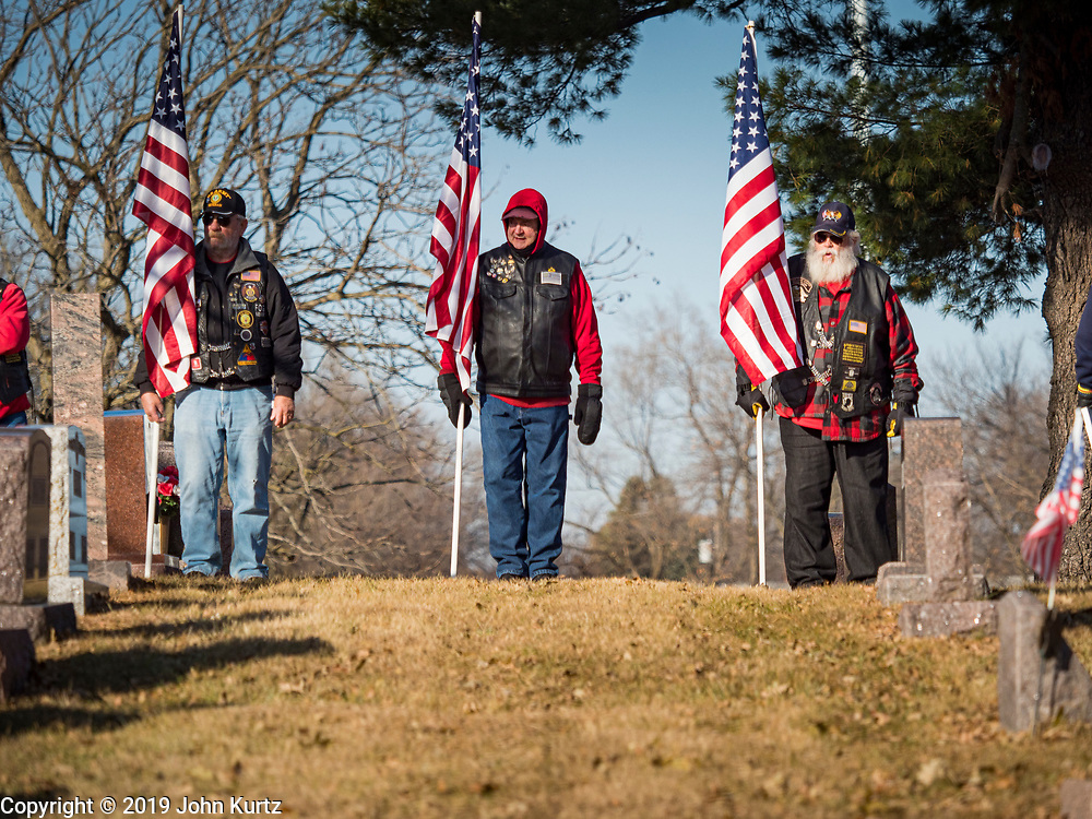 22 NOVEMBER 2019 - DES MOINES, IOWA: Members of the Patriot Guard Riders stand at attention during the reinterment service for Marine Corps Reserve Private Channing Whitaker at the Glendale Cemetery. Whitaker died in the Battle of Tarawa on Nov. 22, 1943 during World War Two. He was buried on Betio Island, in the Gilbert Islands, and his remains were recovered in March 2019. He was identified by a DNA match with surviving family members in Iowa. Whitaker was reintered in the Glendale Cemetery in Des Moines exactly 76 years after his death in World War Two. About 1,000 US Marines and sailers were killed in four days during the Battle of Tarawa.            PHOTO BY JACK KURTZ