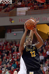 14 February 2015:  Reggie Lynch tries to dislodge a shot from behind shooter Darius Carter during an NCAA MVC (Missouri Valley Conference) men's basketball game between the Wichita State Shockers and the Illinois State Redbirds at Redbird Arena in Normal Illinois