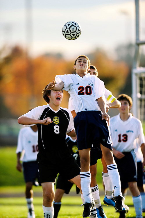 (staff photo by Matt Roth)..Reservoir's Marcus Lyons (#20) heads the ball over the brow of Mount Hebron's Gareth Johnson (#8), while Lyon's teammate Brad Carrion peeks over his shoulder on the jump. Reservoir's jv soccer team was shut out 0-2 by guest Mount Hebron Thursday, October 22, 2009..