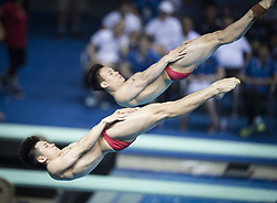 June 5, 2018 - Wuhan, China - China's CAO YUAN (L) and XIE SIYI compete during the men's 3m springboard synchronized final at the FINA Diving World Cup 2018 in Wuhan, central China's Hubei Province. Cao Yuan and Xie Siyi claimed the title with a total of 448.74 points. (Credit Image: © Xiao Yijiu/Xinhua via ZUMA Wire)