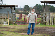 Johnny Heflin poses for a portrait at his ranch after a meeting with the EPA, Army and local residents to discuss the disposal of 15 million pounds of M6 located at Camp Minden in Doyline, Louisiana on March 11, 2015. Heflin lives less than two miles from Camp Minden and is afraid some disposal methods will pollute the air and water that could lead to complications for his family and livestock. (Cooper Neill for The New York Times)