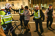 Police scuffle and let go of a young protestor who previously tried to escape being caught during clashes in central London on Wednesday, June 3, 2020. (Photo/ Vudi Xhymshiti)