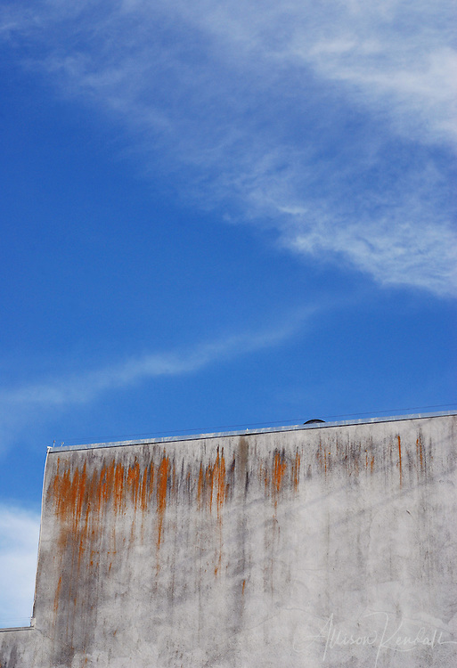 Blue skies rise above a rusted, weathered rooftop.<br /> <br /> Prints: https://bit.ly/CanneryRow-abstract
