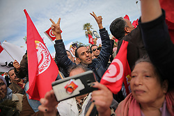 November 22, 2018 - Tunis, Tunisia - Unionists and demonstrators wave Tunisian flags and make victory signs as they took part in a rally held by the Tunisian General Labour Union (French: UGTT) outside the building of the Assembly of the representatives of the people (ARP) in Bardo, Tunis on November 22, 2018 amid the general strike called by the UGTT after unsuccessful pay rise negotiations with the government of Youssef Chahed. (Credit Image: © Chedly Ben Ibrahim/NurPhoto via ZUMA Press)