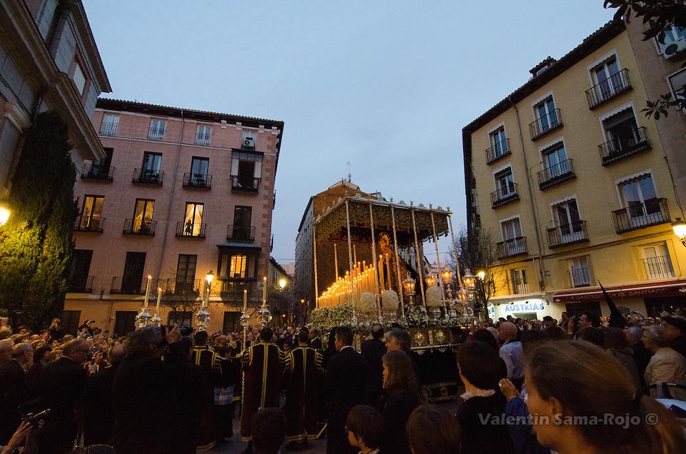 Float of virgin 'Maria Santisima Inmaculada Madre de la Iglesia' at Santiago square in Madrid during Palm Sunday procession.