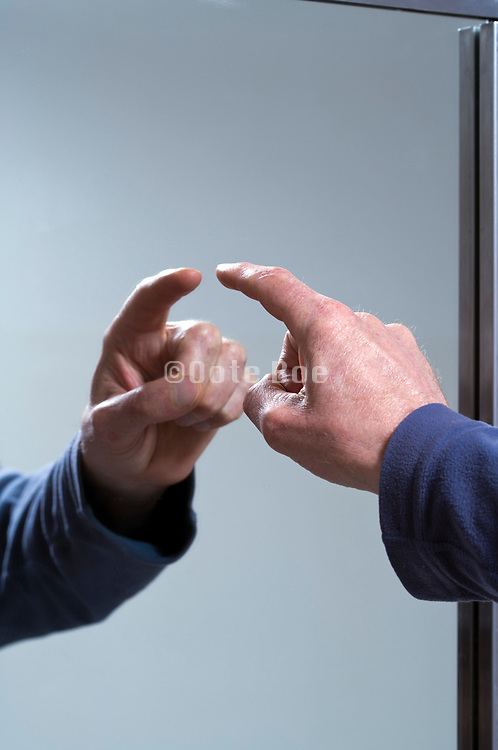 finger pointing in mirror