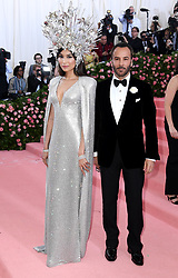 "Gemma Chan and Tom Ford at the 2019 Costume Institute Benefit Gala celebrating the opening of ""Camp: Notes on Fashion"".<br />