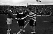 25/04/1965<br /> 04/25/1965<br /> 25 April 1965<br /> F.A.I. Cup Final: Shamrock Rovers v Limerick at Dalymount Park, Dublin. Limerick Captain, Fenton (left) greets Shamrock Rovers Captain Tuohy before the game with the referee S. Spillane of Cork looking on.